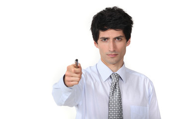 man in a suit holding a pen