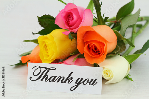 Thank you note and colorful bouquet of roses
