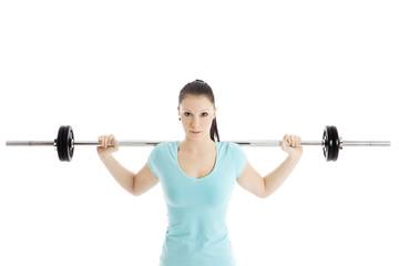Sportliche Frau mit Langhantel