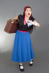 running woman with retro suitcase