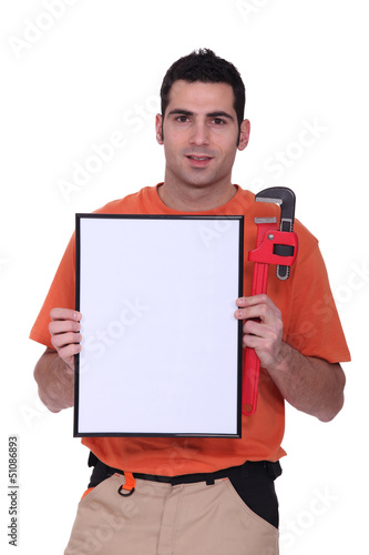 handyman showing a little white panel
