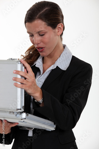 Woman opening metal briefcase