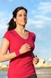 Fitness girl running on beach