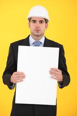 Architect holding advertising panel