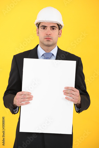 Architect holding advertising panel