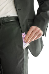 Front view of businessman putting money in his pocket