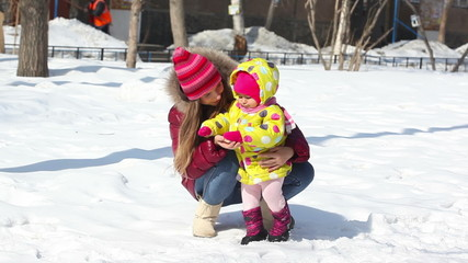 Happy mother with  her daughter in winter outside