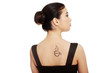 Woman in dress with coffee symbol on her back.