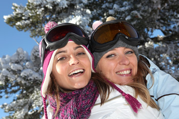 Two women ready to ski