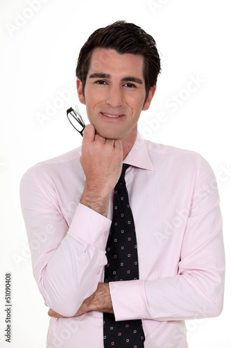 Businessman holding glasses
