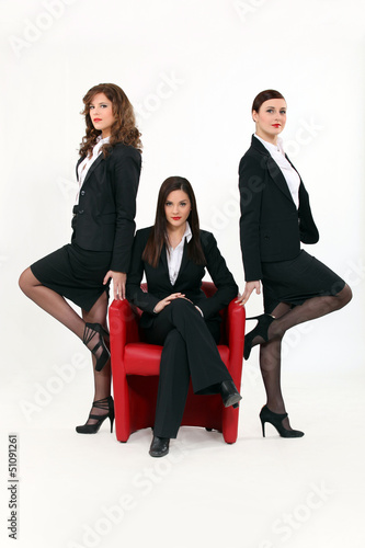Three young sexy women in smart suit