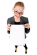 Portrait of smiling business woman with blank board