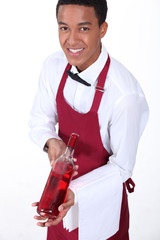 Waiter presenting bottle of wine
