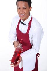 Waiter presenting bottle of wine