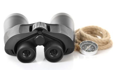 Black modern binoculars with rope and compass isolated on white