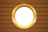 Yellow porthole window on wooden wall