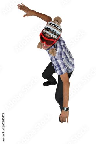 Boy dressed in snowboarding apparel