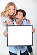 Couple with white board