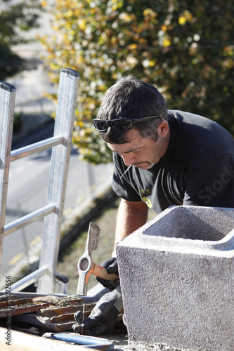 Roofer hard at work
