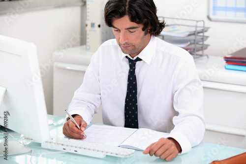 manager in his office with laptop