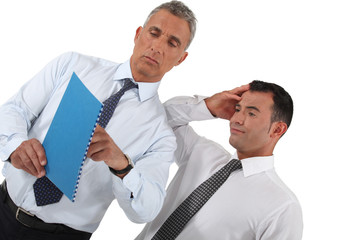 Businessmen looking at document