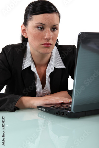 Bored woman staring at her laptop