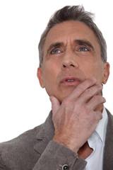 Senior businessman musing