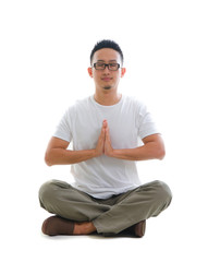 chinese male performing yoga with white background