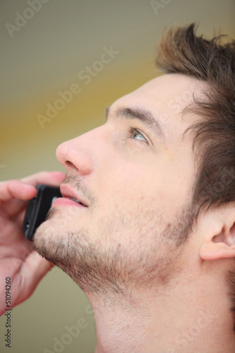 Close-up of man on mobile telephone