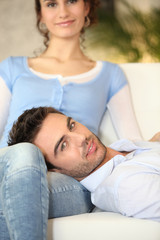 Man on his girlfriend's lap