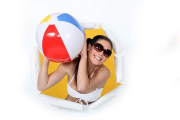 Woman in bikini with an inflatable ball.