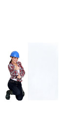 female craftswoman thumb up posing near board