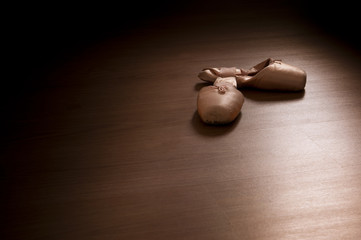 Pointe shoes on wooden floor