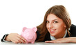 Young beautiful woman sitting with piggy bank (money box),