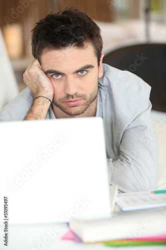 serious-looking guy with laptop