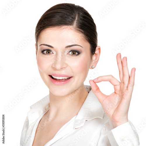 Young happy woman with ok sign