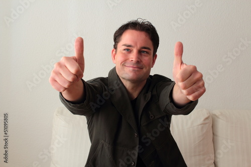 Attractive man with both thumbs up