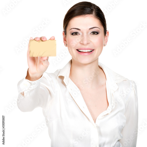 Portrait of smiling woman in a white shirt with credit card