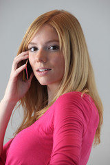 Portrait of young blond woman with mobile phone