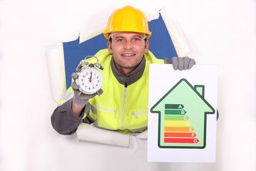 Tradesman holding an energy efficiency rating chart and clock