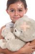 Little girl and teddy bear injured