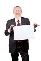 Businessman holding blank sheet of paper