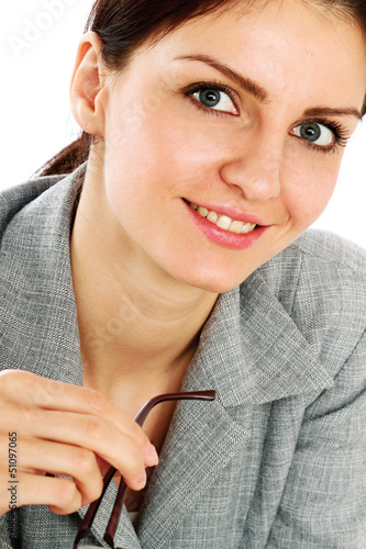 Happy businesswoman sitting on the desk.