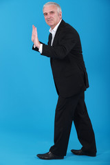 Businessman making stop gesture