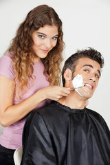 Scared Man Being Shaved By Female Barber