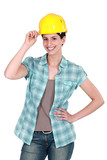 Female builder touching hat