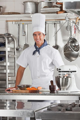 Confident Chef Standing In Restaurant Kitchen