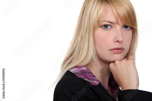 portrait of a thoughtful woman putting her chin on the fist