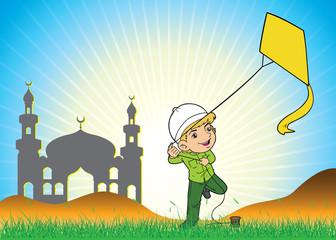 Muslim boy playing a kite in the field