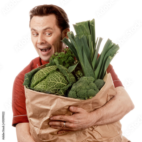 Man holding bag full of vegetables